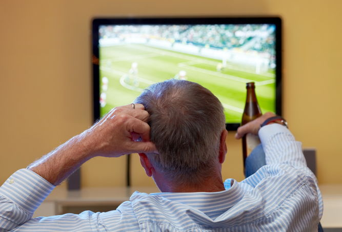 Fan Watching Game On TV